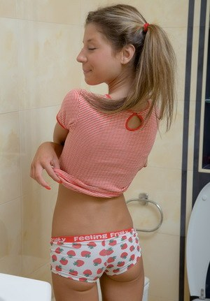 Adorable teen Stephanie shows her skinny body while taking a pee on toilet