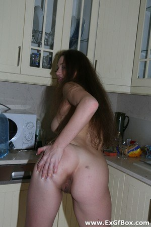 Ex-girlfriend finger spreads her naked pussy after dark in the kitchen
