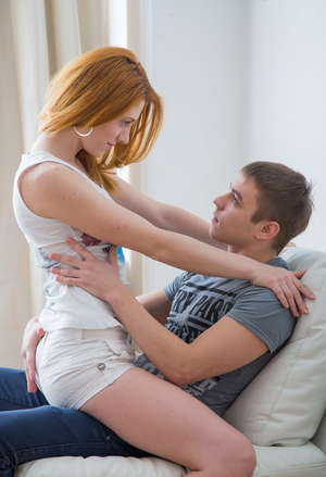 Young redhead with firm tits seduces her man friend in shorts