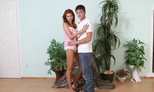 Slender redheaded teen and her man friend experiment with sexual positions
