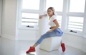 Hot blonde Jessa Rhodes takes of blue jeans to pose nude in red sneakers