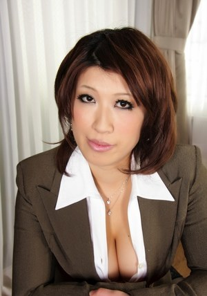 Japanese MILF exposes big natural tits in nylons and garters