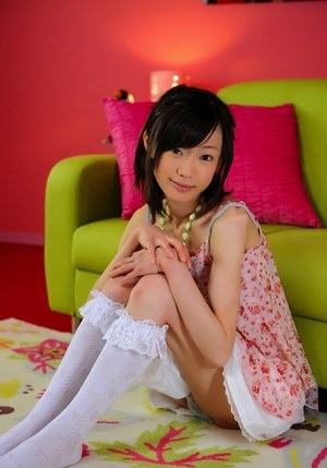 Petite Japanese girl with a pretty face models non nude in knee socks