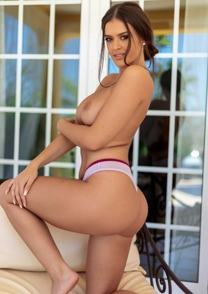 Leggy brunette Brook Wright uncovers her big naturals in solo action