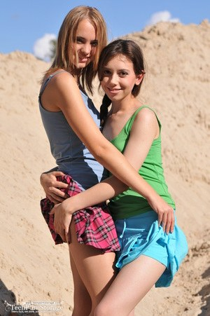 Teen girls Dana and Lisa take the nude modelling plunge together on beach dune