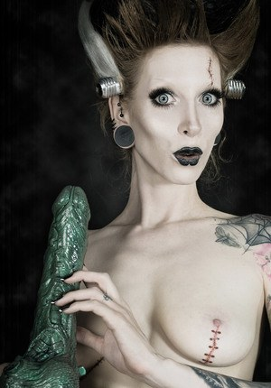 Tattoo model Razor Candi sucks on a big dildo in Bride of Frankenstein attire