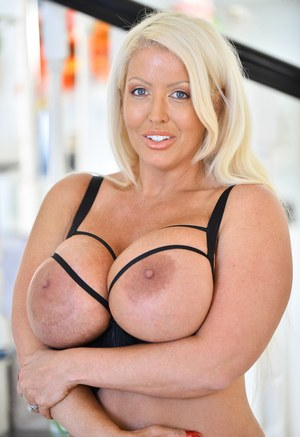 Blonde amateur Danielle puts her round tits on display as she disrobes outside