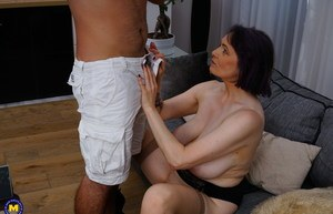 Horny grandmother seduces her son-in-law in a black skirt and stockings