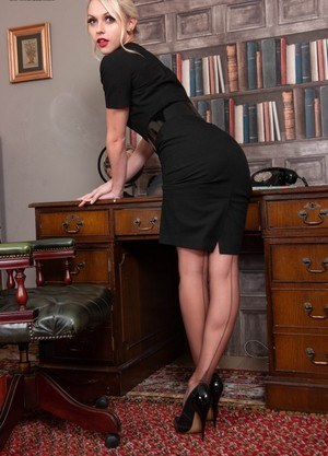Hot blonde secretary Chloe Toy shows her bald twat in girdle and retro nylons