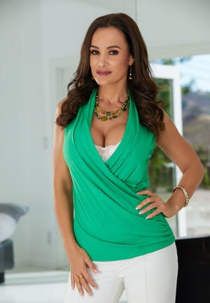 Brunette housewife Lisa Ann uncups her big tits in lace underwear