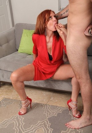 Older redhead Andi James seduces and fucks a younger stud