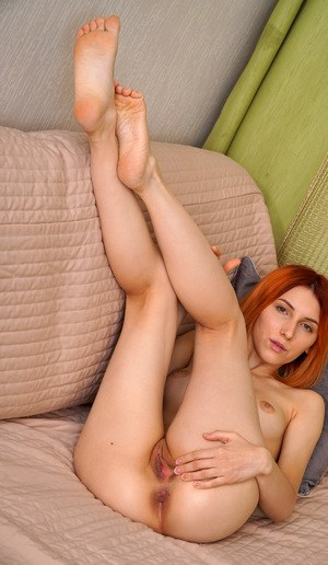 Sexy redhead Elina Holm touts her hot ass before showing the pink of her twat