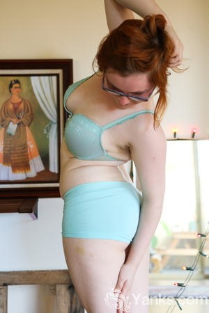 Pale redhead Panda shows her unshaven chubby body with her glasses on