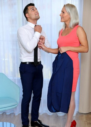 Hot older woman Kathy Anderson seduces her son-in-law as he readies for work