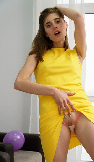 Solo girl Amelinda removes dress and knee socks before masturbating