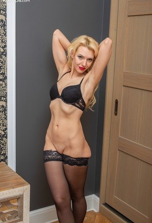 Mature MILF Milena strikes great poses in red lips and black stockings
