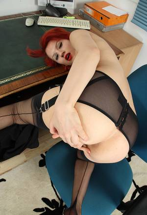 Hot redhead removes glasses and dress before showcasing her trimmed bush