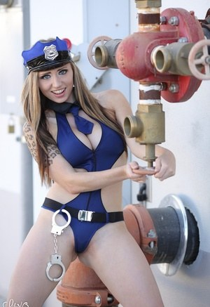 Amateur model Lily Xo strikes great non nude poses in cop hat and handcuffs
