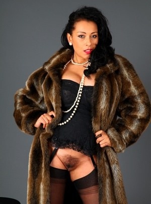 Classy older lady Danica Collins frees big tits and bush from fur coat