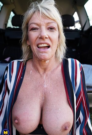 Mature blonde woman eats a banana before a gangbang in the countryside
