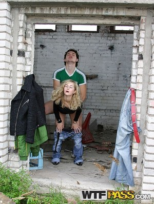 Blonde girl does hardcore anal in an abandoned building with strangers