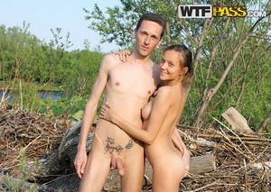 Young looking girl takes off her clothes to go naked in the great outdoors