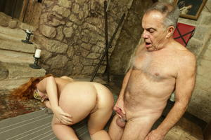 Natural redhead is banged in the dungeon by her old Master wearing a collar