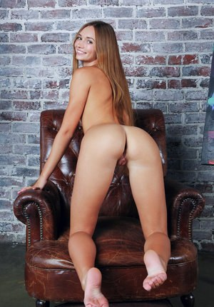 Totally naked teen with hair that reaches her ass to die for strikes hot poses