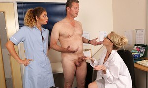 Clothed women from the health profession jerk off a naked man
