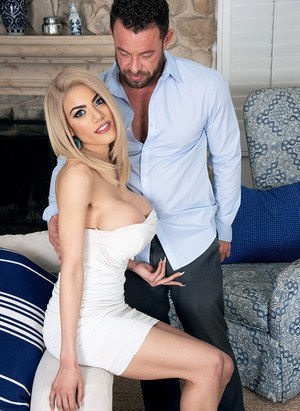 Blonde chick with huge tits Amber Alena is relieved of short dress before sex