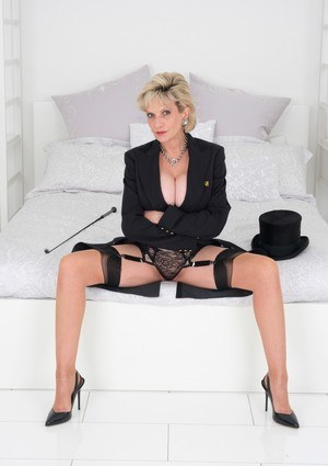 Classy mature woman Lady Sonia dons a top hat while showing her big tits