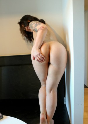 Naughty housewife Chasey Devil takes off her clothes to pose naked in glasses