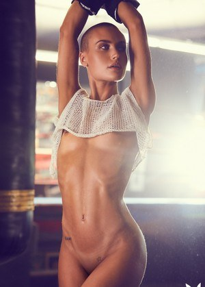 Athletic woman Vendela models semi-nude in boxing attire with a sweat on