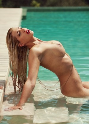 Hot blonde Sarah Nowak models naked for Playboy in and out of swimming pool