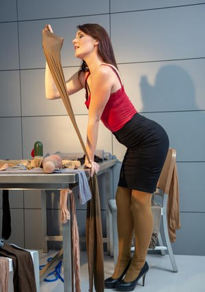 Tall woman adorns herself and her sex toys in many layers of pantyhose
