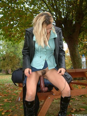 Horny blonde hikes her miniskirt in order to masturbate in a public place