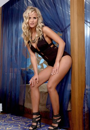 Hot blonde Miela toys her shaved pussy during a centerfold shoot