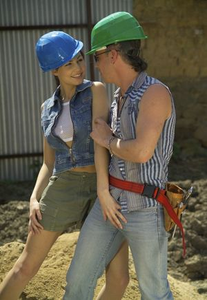 Hot brunette seduces and fucks a man on a construction site