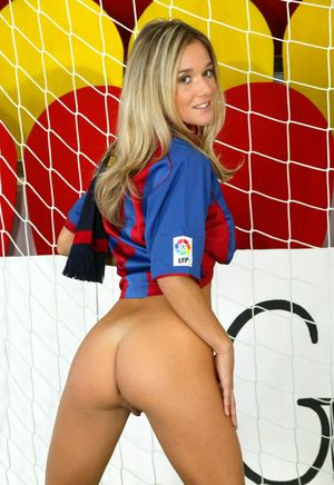Sexy blonde shows her tits and twat while keeping goal for soccer club