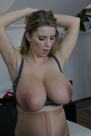 Solo girl Katerina Hartlova releases her huge tits in hose while pregnant