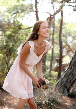 Young looking girl flashes her tight slit while getting naked in the forest