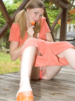 Amateur girl Marie Mccray pulls down her cute panties on back deck