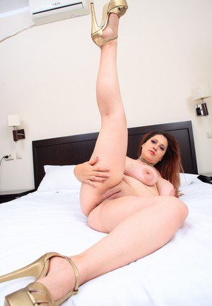 Thick female Crazy Maria watches herself getting naked in bedroom mirror