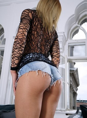 Teen model Lara West touts her sex ass in jean shorts before toying her pussy