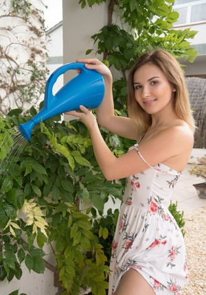 Nice teen Anata pours water over beautiful body instead of watering the plants