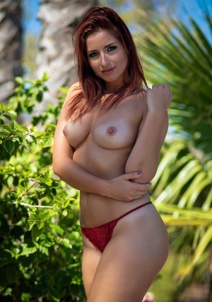 UK amateur Harley Gacke sheds her dress and lingerie to pose nude in a garden