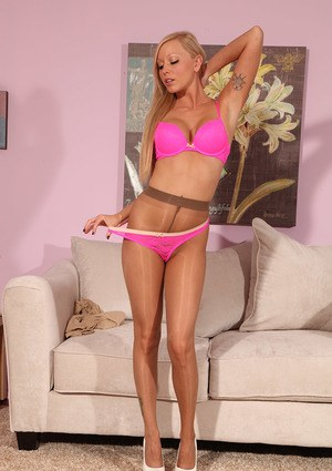 Natural blonde releases her pantyhose covered feet from verboten heels