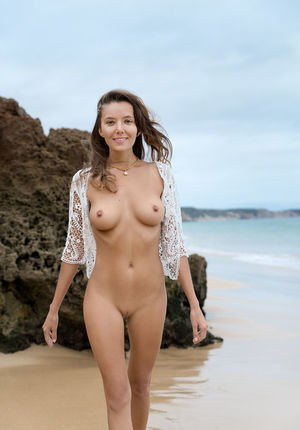 Teen beauty Clover displays her great body while totally naked in a sea cave