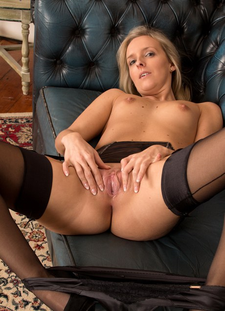 Stocking adorned blonde mom revealing small tits and nice ass