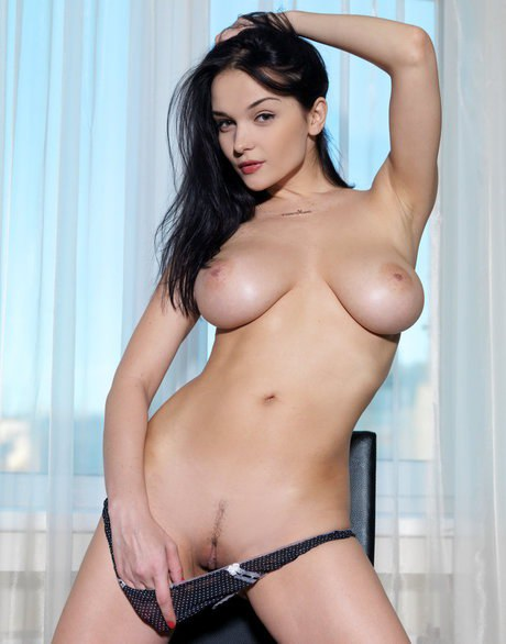 Erotic model Jenya D in black thong undressing to flaunt big boobs & hot pussy